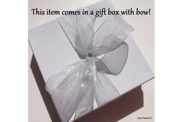Gift box with bow included with your order