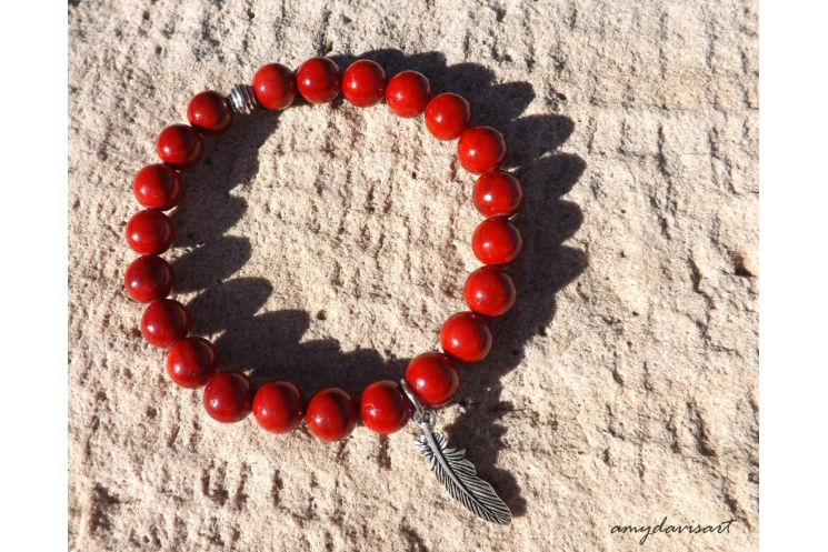 Red bracelet with feather charm for women
