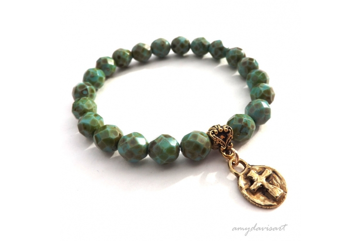 Cross bracelet in gold bronze