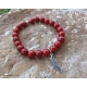 Feather charm stacking bracelet with red beads
