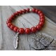 Red beaded stretch bracelet with feather charm