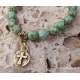 Turquoise green bracelet with rustic cross charm